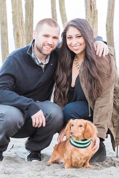 Photo of hygienist Katherine with her husband and dog on the beach