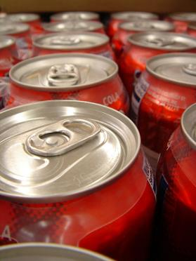 Several cans of soda pop full of fructose corns syrup.